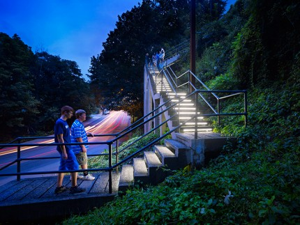 South 18th Street Steps, by Loysen + Kreuthmeier Architects. This public through-way, a seven-story stairway connecting the Flats and Slopes neighborhoods, was in need of repair, better lighting, and signage. The solution celebrates the gateway and broadcast a positive message about the Slopes. Photo credit Massery Photography, Inc.