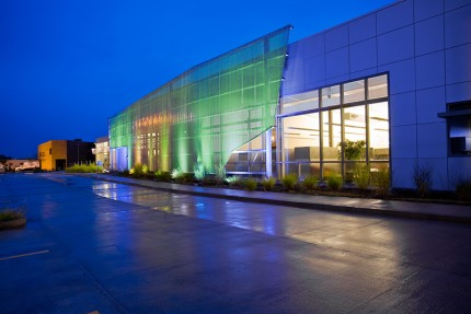 amar Advertising Operations Center, by Renaissance 3 Architects, P.C., embraces the idea of the building as billboard via its illuminated mesh screen with programable LED lighting. Photo credit Massery Photography, Inc.