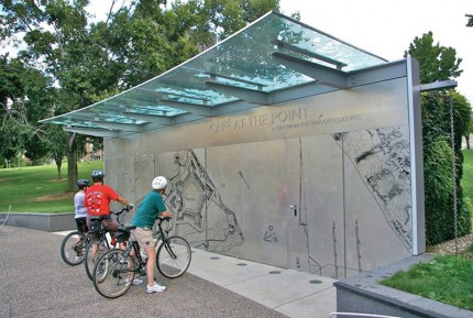 """Cafe at the Point, designed by Pfaffmann + Associates, is made up of an """"interpretive wall… etched stainless steal panels on the front facade highlight historical significance of site."""" Photo credit Pfaffmann + Associates."""
